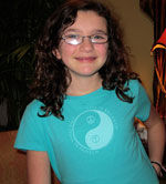Mackenie wearing a Life is Balance Peace Tee for girls