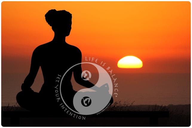 Yoga pose at sunset with Life is Balance yoga logo